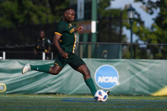Vermont's Mikel Kabala (12) kicks the penalty shot for a goal during the men's soccer game between the LIU Brooklyn Blackbirds and the Vermont Catamounts at Virtue Field on Sunday afternoon September 2, 2018 in Burlington.