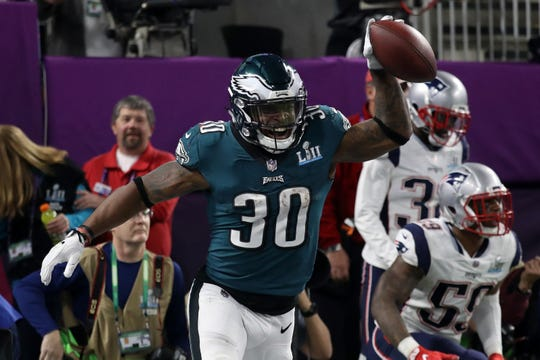 Glassboro native Corey Clement, shown here after scoring a touchdown in Super Bowl LII, didn't want to play anywhere else except Philadelphia. He signed a 1-year deal to stay with the Eagles this week.