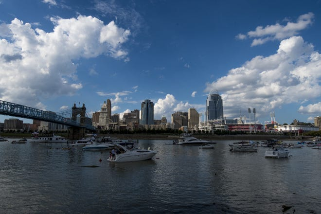 Boats travel up and down the river ahead of the 42nd annual WEBN fireworks over the Ohio river Sunday, September 2, 2018.