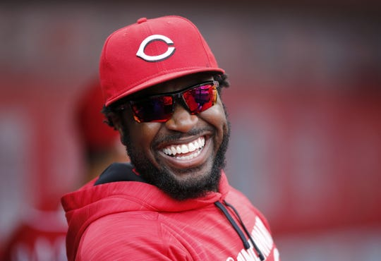 Cincinnati Reds second baseman Brandon Phillips (4) emerges from the clubhouse in the third inning of the MLB National League, regular season finale, game between the Cincinnati Reds and the Chicago Cubs at Great American Ball Park in downtown Cincinnati on Sunday, Oct. 2, 2016.
