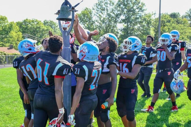 Finneytown players ring the victory bell after the first win since October 2014.