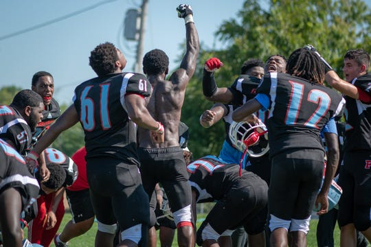 Finneytown players celebrate the first win since 2014.
