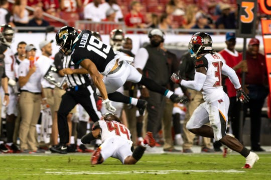 Jacksonville Jaguars wide receiver Allen Lazard (19) is tackled after making a reception by Tampa Bay Buccaneers corner back Amari Coleman (44) during the second half at Raymond James Stadium.