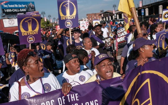 SEIU Local 1 members chant while preparing to march along Michigan Avenue during the annual Labor Day parade in the Corktown neighborhood of Detroit on Monday, September 3, 2018.