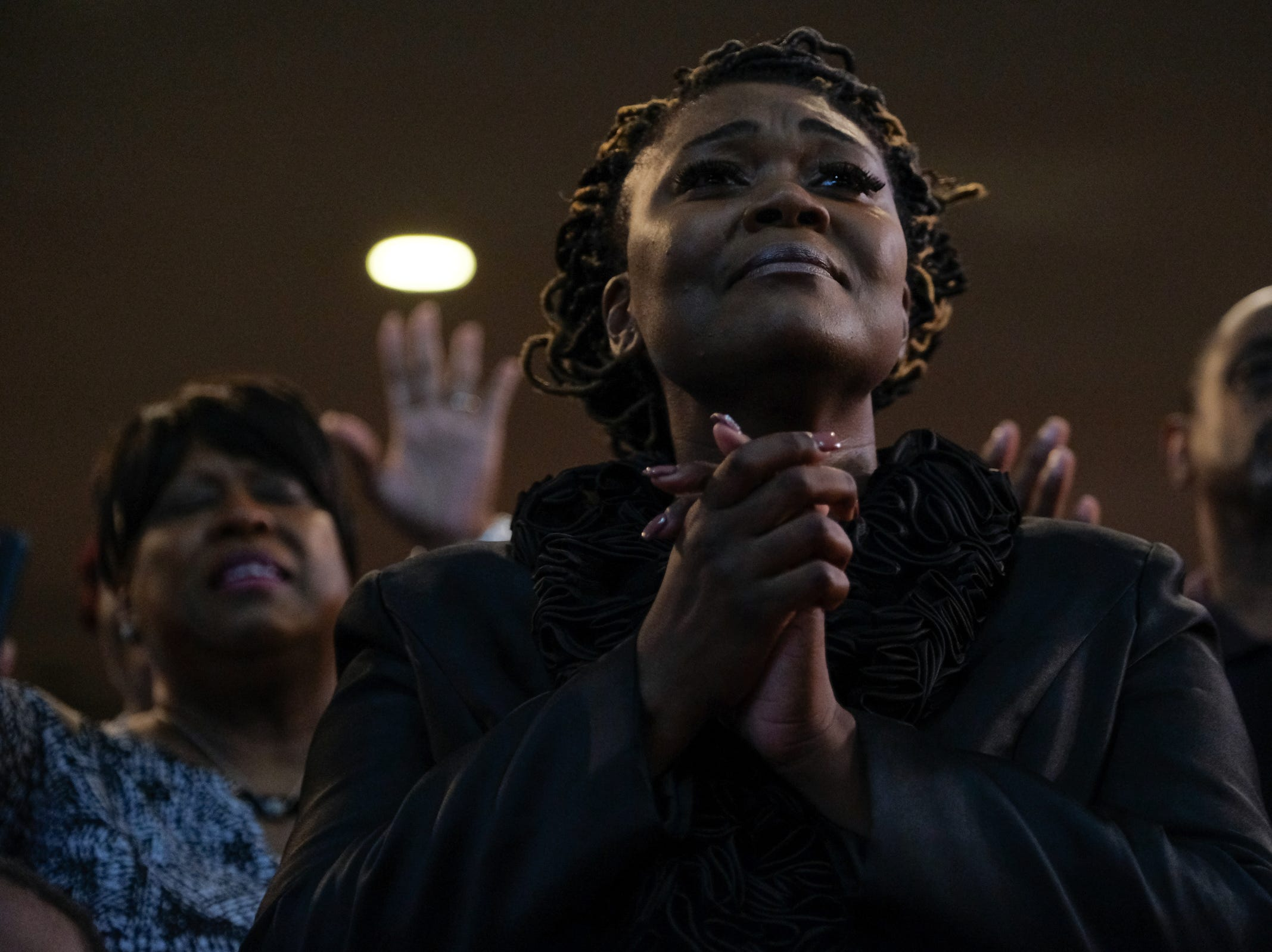 Singer Dezmonicka Jones listens to a speaker as she waits to perform during a gospel tribute concert for the late Aretha Franklin at New Bethel Baptist Church in Detroit on Monday, August 27, 2018.