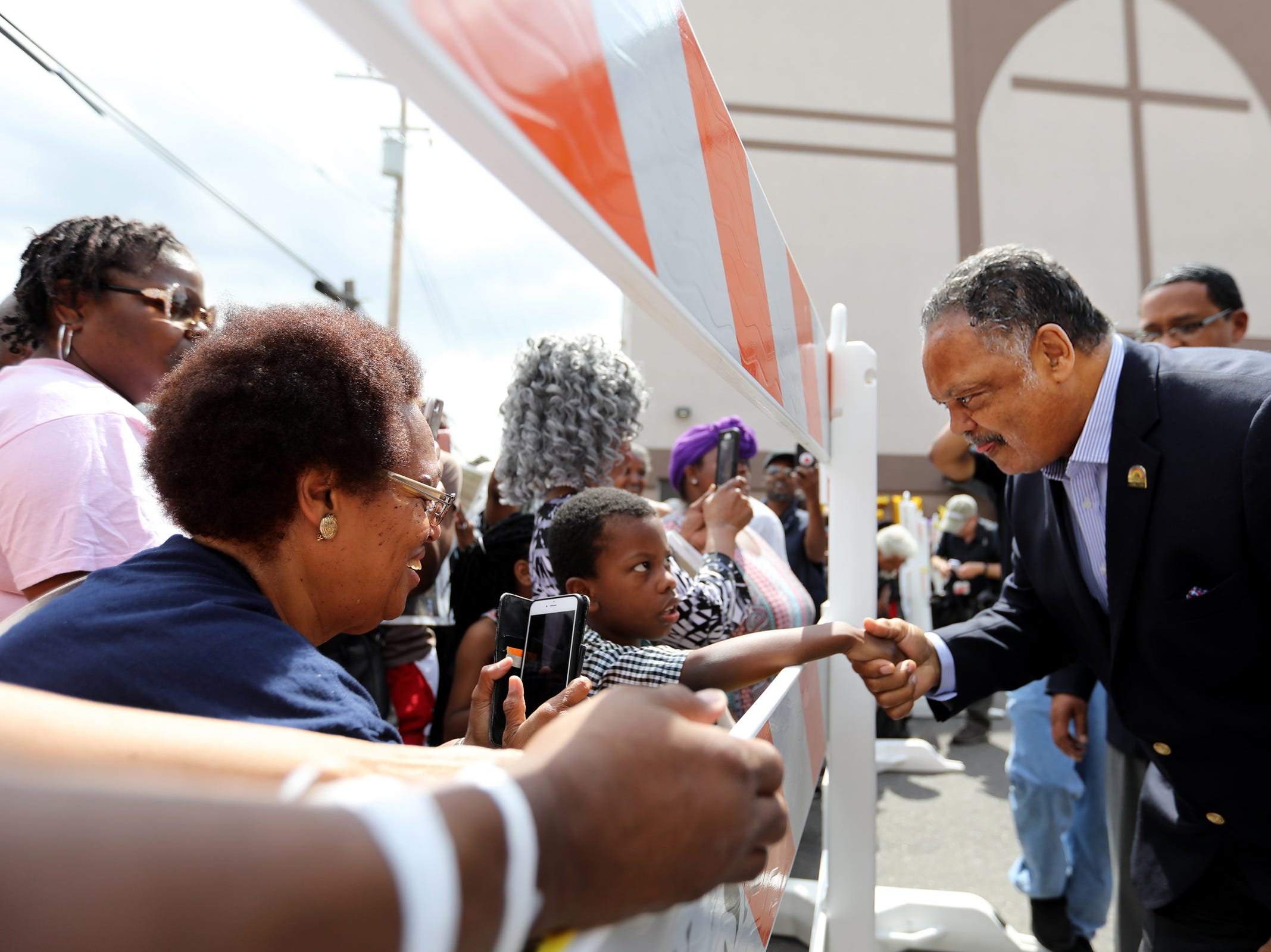 Rev. Jesse Jackson greets the crowd at a public viewing for Aretha Franklin at New Bethel Baptist Church in Detroit on Thursday, Aug. 30, 2018.
