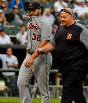 Detroit Tigers' Michael Fulmer leaves the game with a trainer after getting hit by a ball vs. the Chicago White Sox in the sixth inning Monday, Sept. 3, 2018, in Chicago.