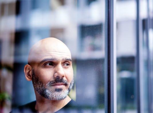 Thoughtful Businessman Seen Through Window