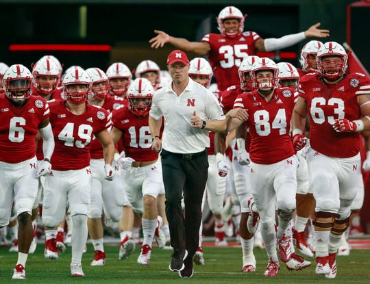 Scott Frost and Nebraska will visit Michigan Stadium on Saturday (AP photo)