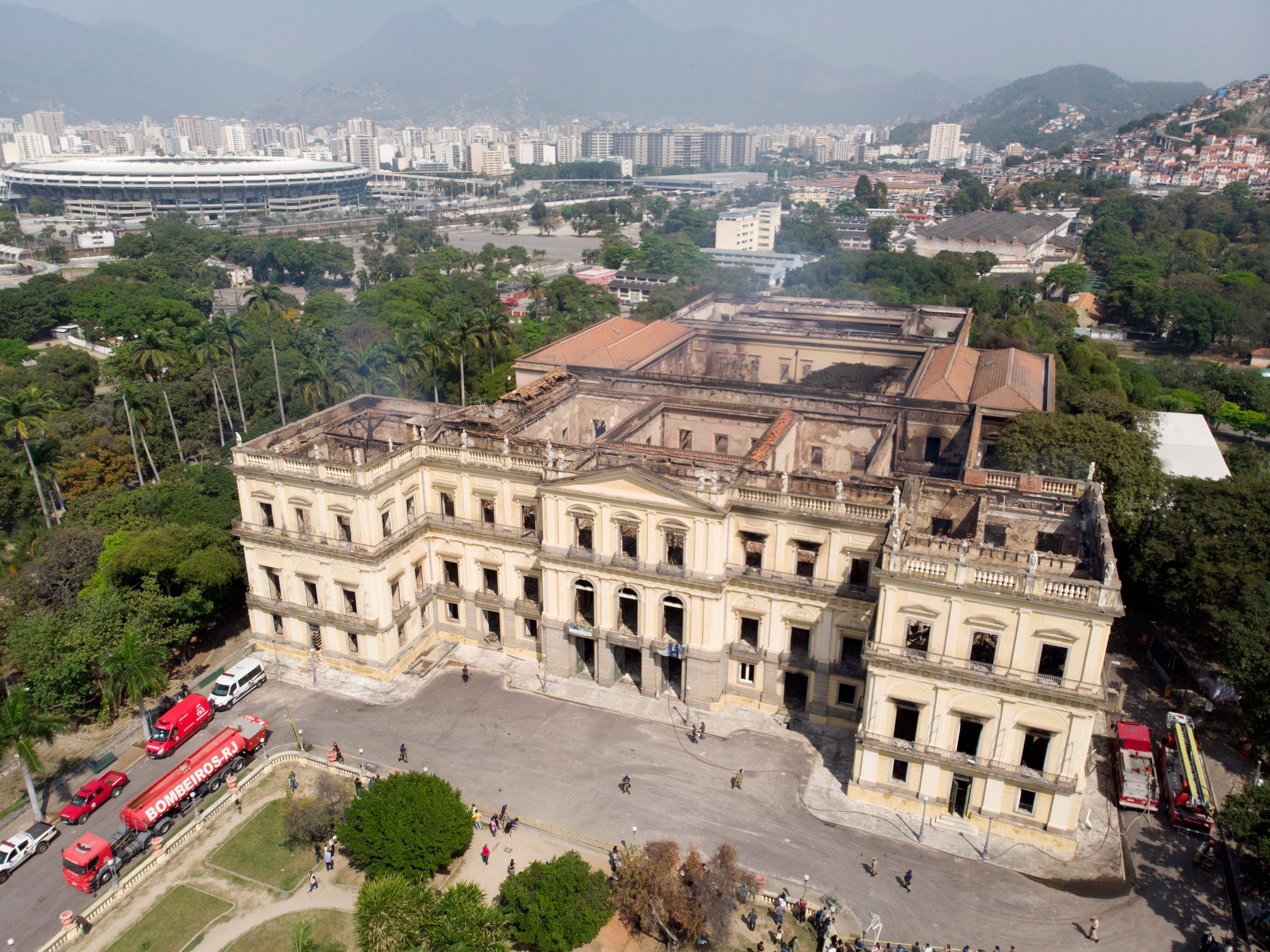 Fire trucks sit parked outside the National Museum after it was gutted by an overnight fire in Rio de Janeiro, Brazil, Monday, Sept. 3, 2018.