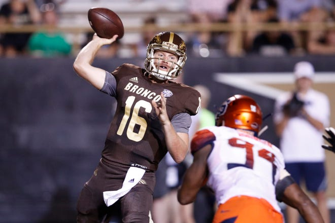 Jon Wassink of the Western Michigan Broncos throws a pass against the Syracuse Orange in the third quarter.