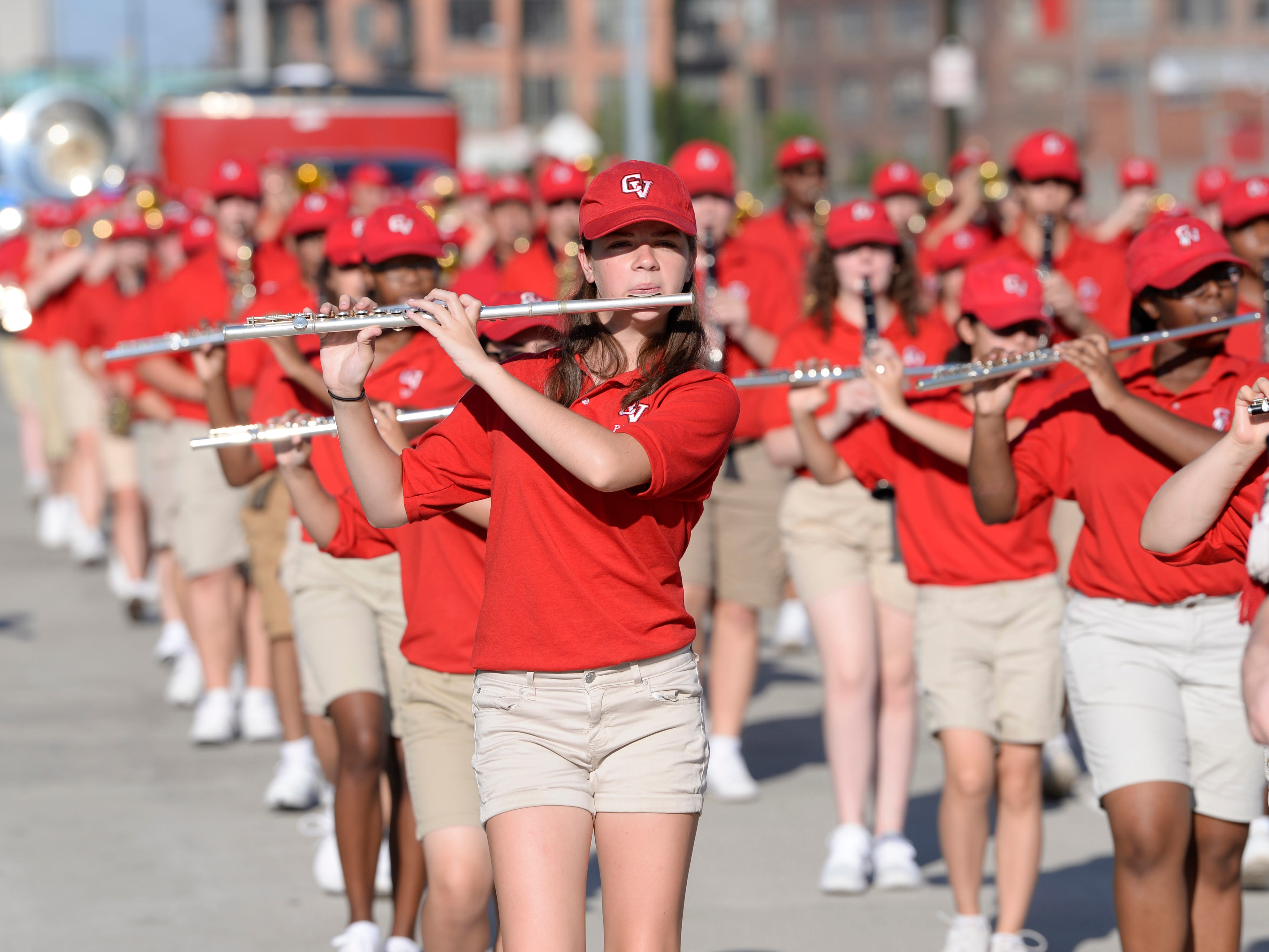 Brianna Harris, 16,  of the Chippewa Valley High School marching band marches along the parade route along Michigan Ave. to Hart Plaza.