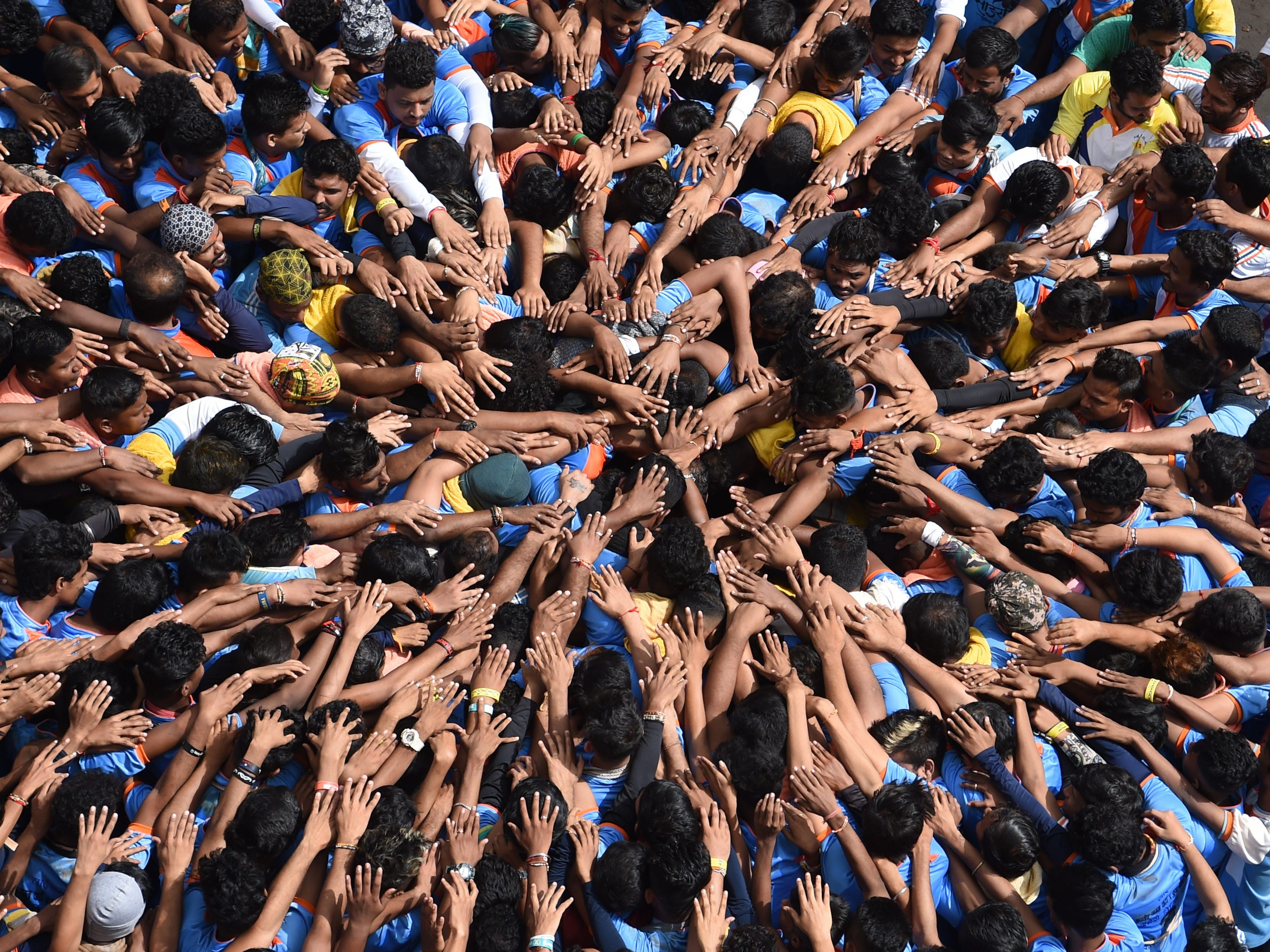Indian Hindu devotees take a vow before forming a human pyramid in a bid to reach and break a dahi-handi (curd-pot) suspended in the air during celebrations for the Janmashtami festival, which marks the birth of Hindu God Lord Krishna, in Mumbai on September 3, 2018.