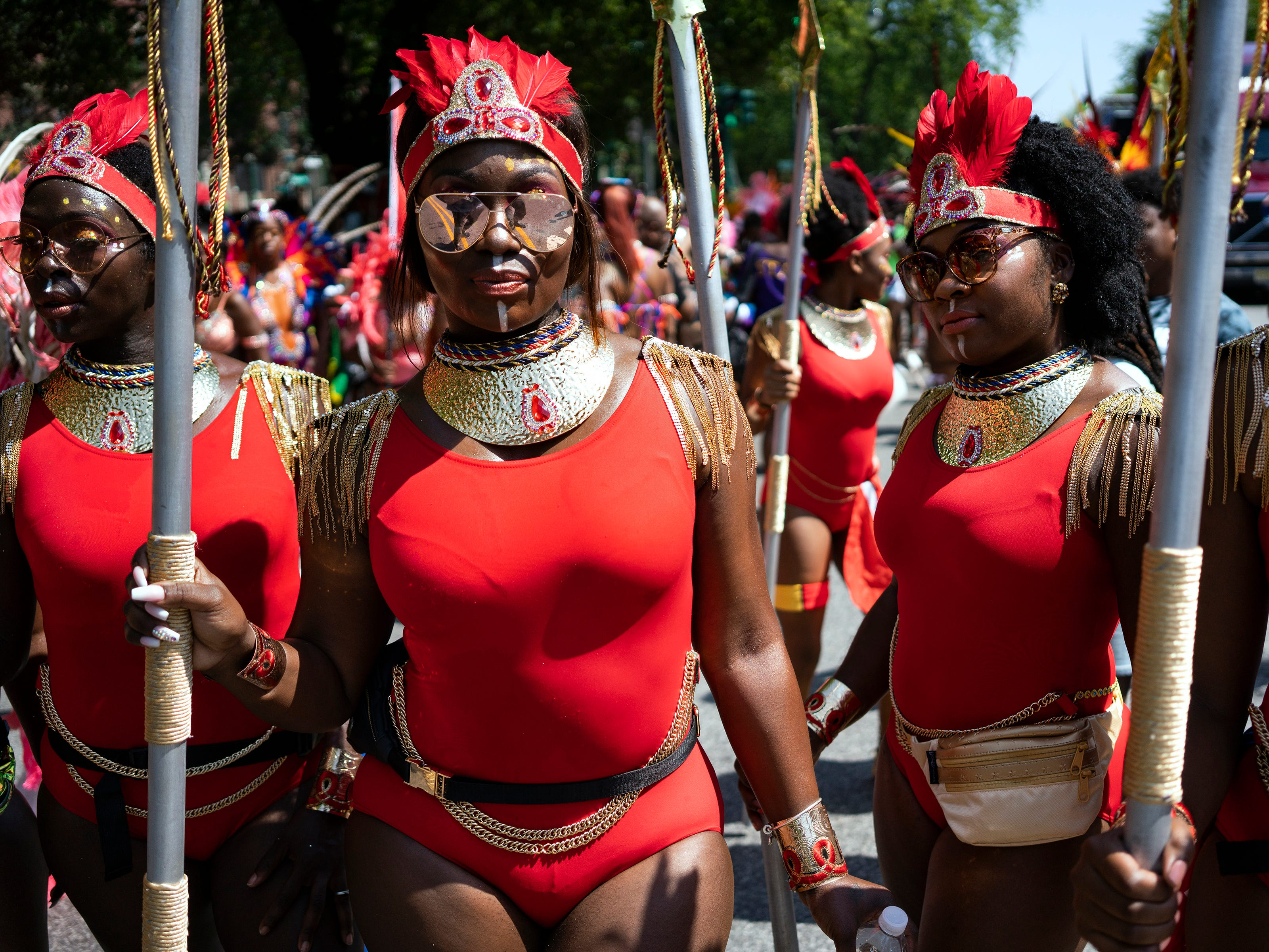 Participants walk along with their parade unit during the West Indian American Day Parade in the Brooklyn borough of New York, Monday, Sept. 3, 2018. New York's Caribbean community has held annual Carnival celebrations since the 1920s, first in Harlem and then in Brooklyn.