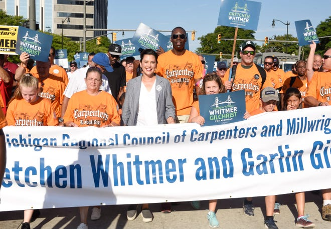 Democratic nominee for governor, Gretchen Whitmer, center, has pledged to repeal Michigan's right-to-work law.