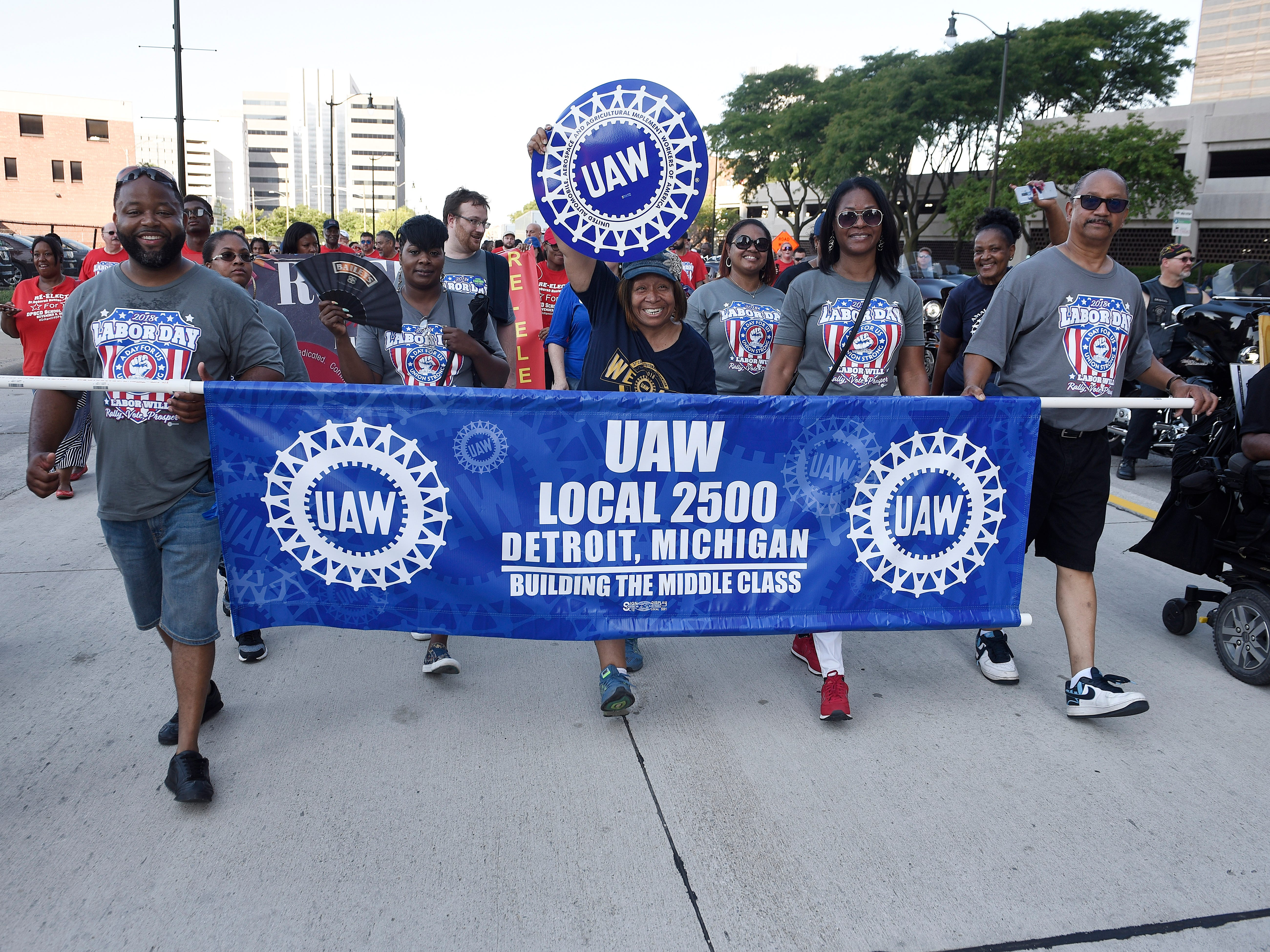 Members of UAW Local 2500 walk the parade route.