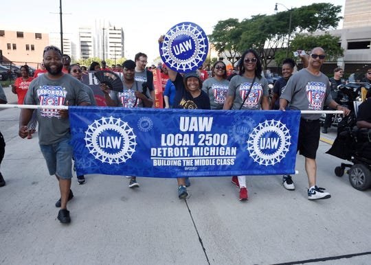 Members of UAW Local 2500 walk the parade route in 2018.