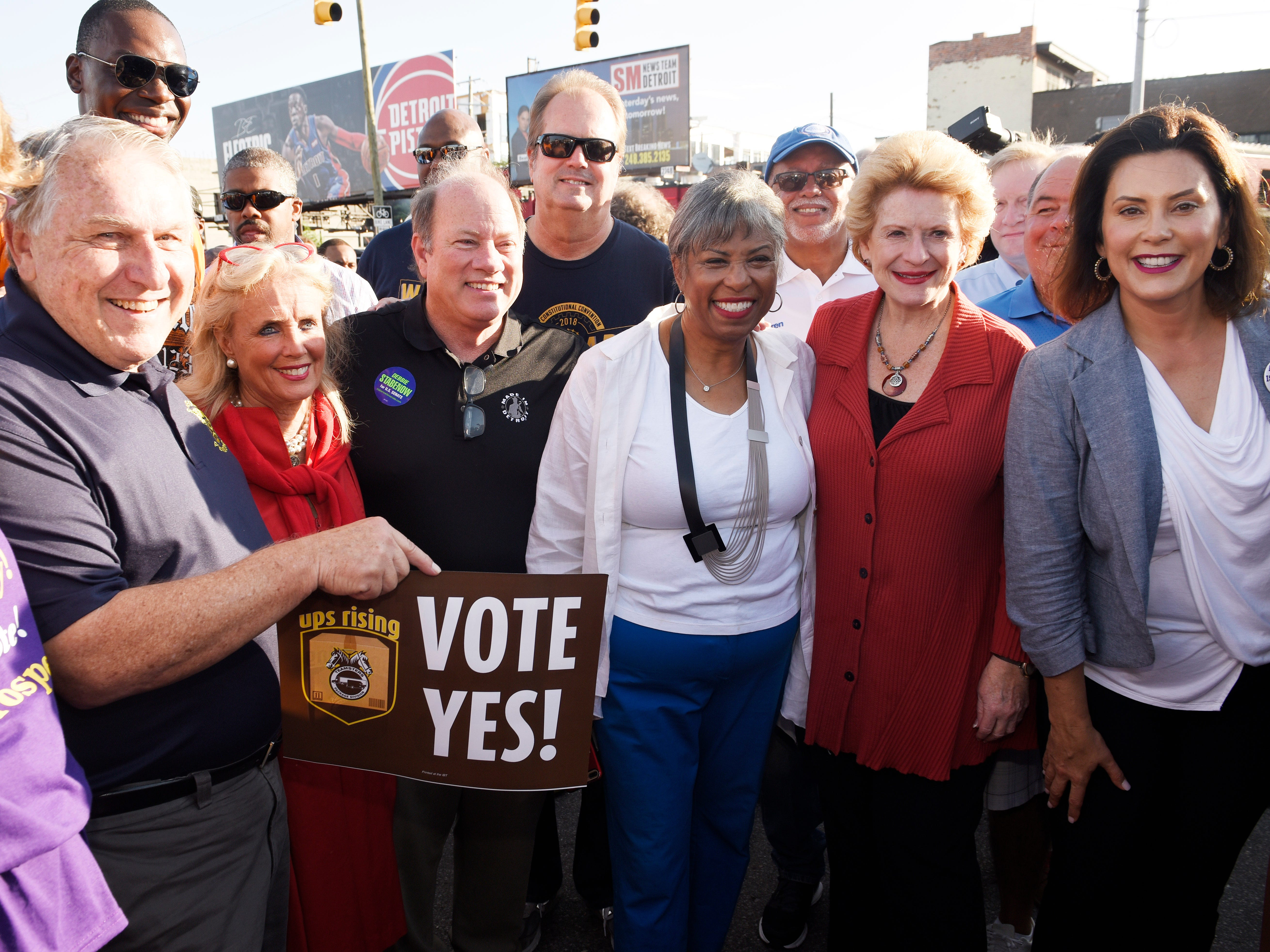 From left, James P. Hoffa, Debbie Dingell, Mayor Mike Duggan, Brenda Lawrence, Debbie Stabenow and Governor nominee Gretchen Whitmer pose for a photo before the kickoff of Detroit's Labor Day Parade.