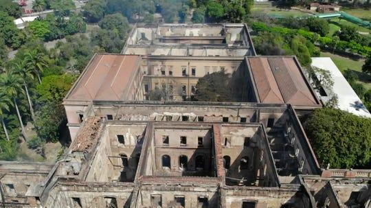 The National Museum stands gutted after an overnight fire in Rio de Janeiro, Brazil, Monday, Sept. 3, 2018.
