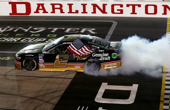 Brad Keselowski celebrates with a burnout after winning the Bojangles' Southern 500 at Darlington Raceway on Sunday.