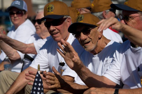 Local 9926 retirees wave to the people line the parade route at the 132nd Annual Labor Day Celebration in Boonville, Ind., Monday morning.