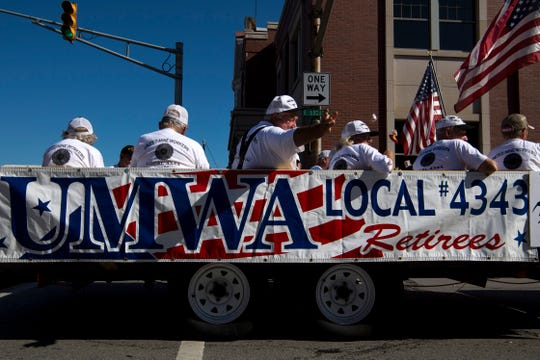 United Mine Workers of America Local 4343 retirees toss candy from a flatbed trailer at the parade for the 132nd Annual Labor Day Celebration in Boonville, Ind., Monday morning.