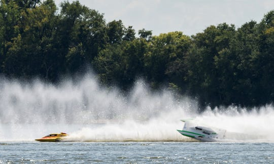 Chris Ritz (right) nearly flips his boat during a National Modified heat race last year at HydroFest. This year, admission to watch the racing on Aug. 16-18 is free.