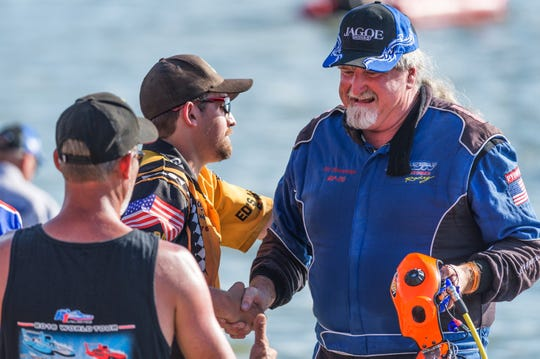 Driver of the Jagoe GP-20 Ed Preston, right, is congratulated by teammates and competitors after winning the Grand Prix Final of the 2018 Evansville (Indiana) HydroFest, on the Ohio River.