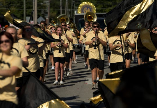 The Band of Gold Marching Band marches along E. Locust Street at the 132nd Annual Labor Day Celebration in Boonville, Ind., Monday morning.