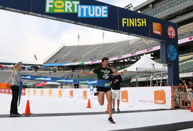 Andrew Epperson, an assistant cross country coach at CSU, was the first runner to cross the finish line Monday at Canvas Stadium in the FORTitude 10K.