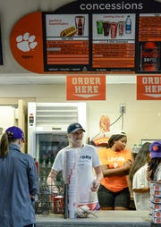 Concession stands workers prepare for the crowd about to be let in the stadium before the game with Furman in Memorial Stadium in Clemson on September 1.