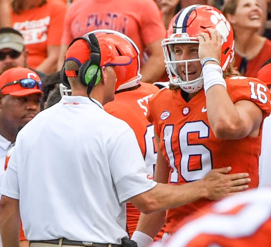 Clemson quarterback coach talks with Clemson quarterback Trevor Lawrence (16) after a Travis Etienne (9) touchdown against Furman during the second quarter in Memorial Stadium in Clemson on September 1.