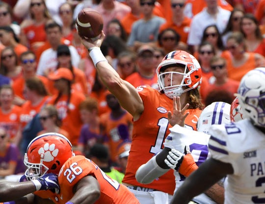 Clemson quarterback Trevor Lawrence (16) throws a pass in the Furman game during the second quarter in Memorial Stadium in Clemson on September 1.
