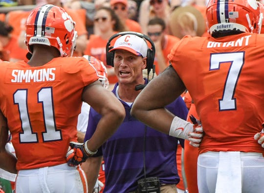 Clemson defensive coordinator Brent Venables sees Clemson safety Isaiah Simmons (11) and defensive lineman Austin Bryant (7) after a defensive stop during the second quarter in Memorial Stadium in Clemson on September 1.