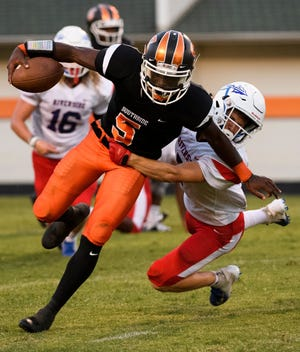 Southside's Jalon Calhoun (5) passed for 256 yards with two touchdowns, rushed for 143 yards with one score and picked off a pass in the Tigers' win over Riverside.