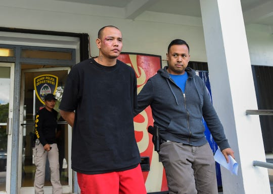Kidnapping suspect Brian Kevin Cruz, 29, is escorted from the Guam Police Department's Hagåtña Precinct on Sept. 3, 2018.