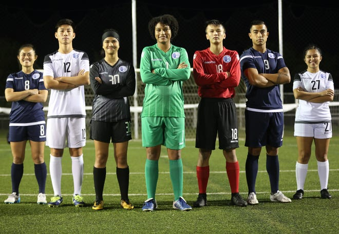 Players from various Guam senior and youth national teams pose for a photo in new kits by Macron, a sports apparel and equipment company based in Bologna, Italy.