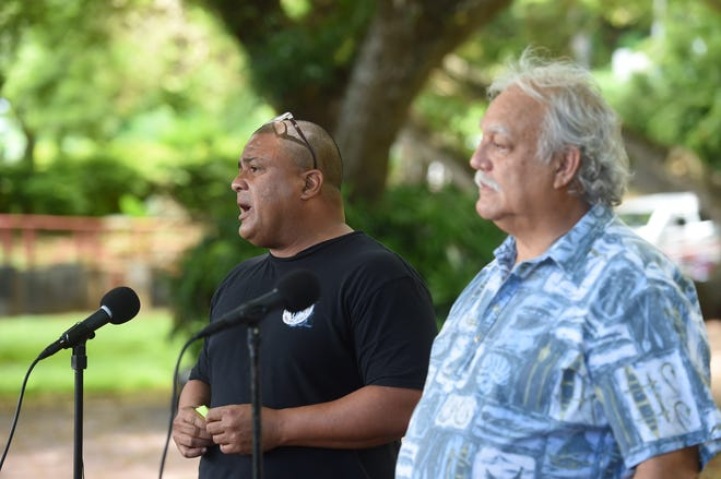 Andri Baynum from Guamanian for fair Government, left, and Ken Leon Guerrero from Guam Citizens for Public Accountability speak at press conference, asking voters to write in Sen. Frank Aguon Jr. for governor in 2018 General Election.