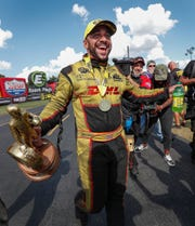 J.R. Todd celebrated a Funny Car win over Matt Hagen during the NHRA U.S. Nationals in 2018 at Lucas Oil Raceway.