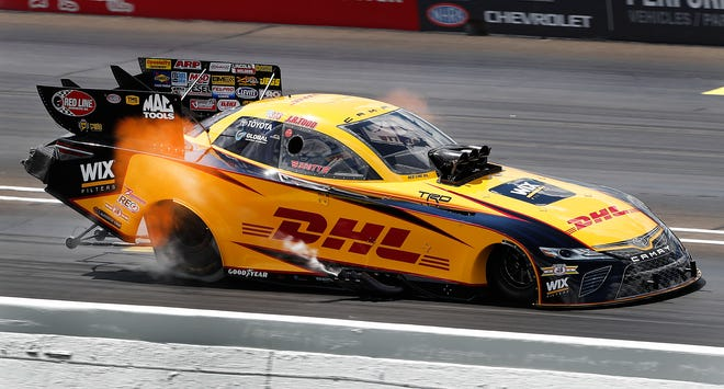 Flames shoot out of the sides of Funny Car driver J. R. Todd during the NHRA U.S. Nationals at Lucas Oil Raceway on Monday, Sept. 3, 2018.