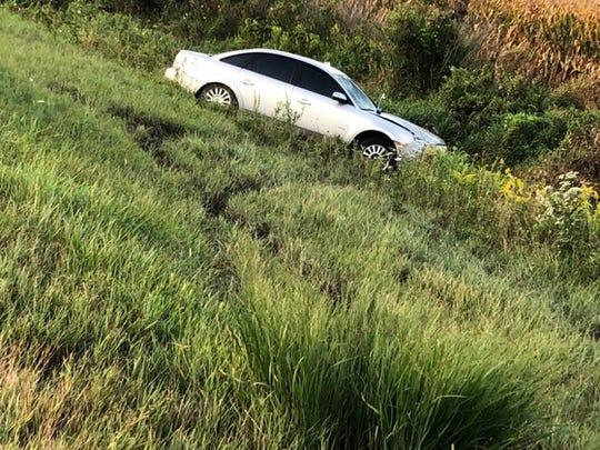 After an unidentified woman was struckand killed on I-65, one mile south of the Remington exit,the motorist's car ran off the highway and down into a ditch, State Police said.