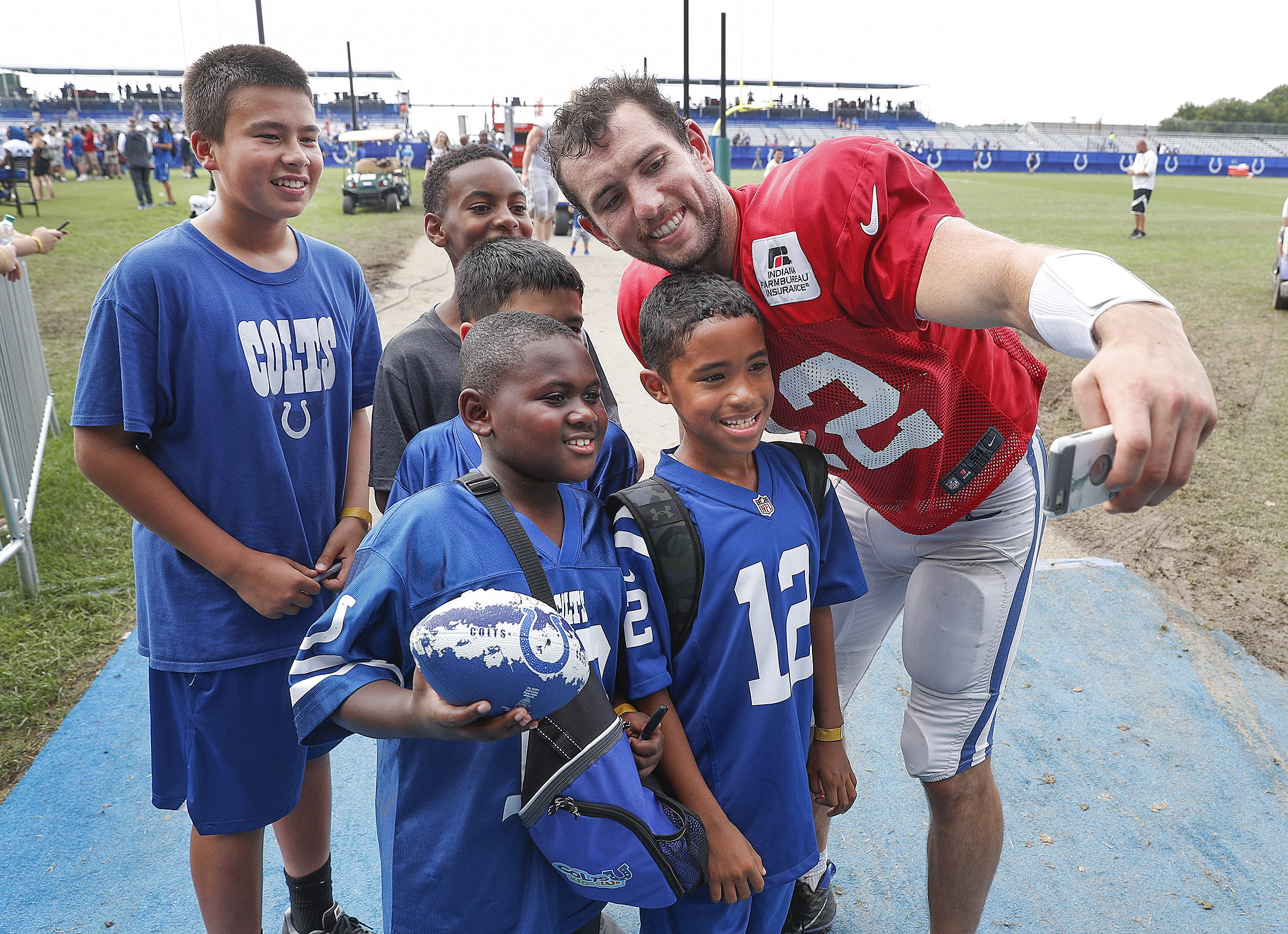 Andrew Luck, here posing for a selfie with fans after practice, has never enjoyed training camp more than he did this year.