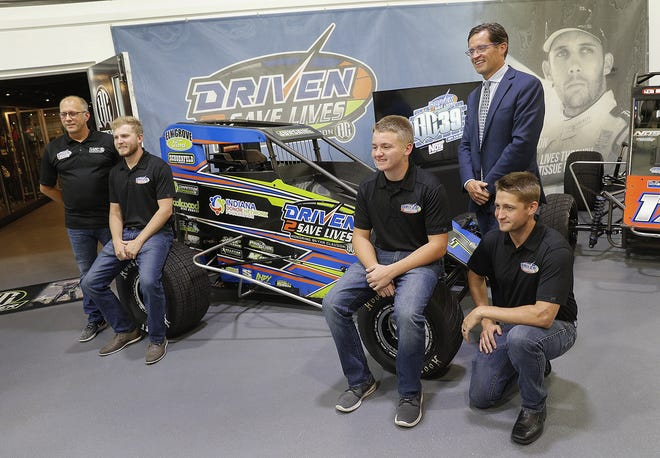 Tim Clauson, father of Bryan Clauson, left, Tyler Courtney, Zeb Wise, Doug Boles and Justin Grant,right, pose for a photo after talking about the inaugural Driven2SaveLives BC39 presented by NOS Energy Drink on Sept. 5-6 at The Dirt Track at IMS at Clauson-Marshall Racing in Fishers on Tuesday, Aug 21.