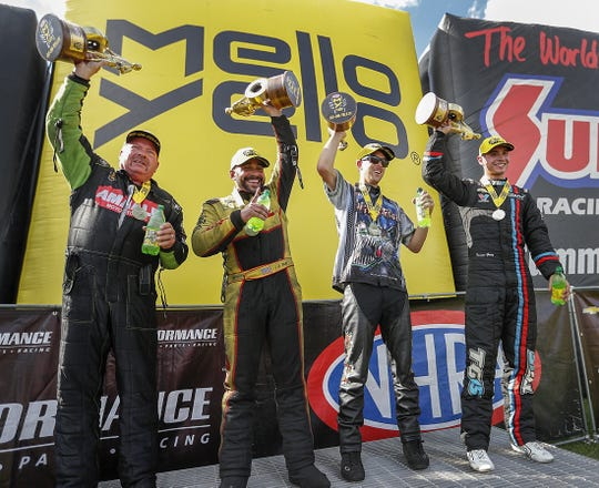 Top Fuel winner Terry McMillen,left, Funny Car winner J.R. Todd, Pro Stock Motorcycle winner LE Longlet and Pro Stock winner Tanner Gray celebrate their wins following the NHRA U.S. Nationals at Lucas Oil Raceway on Monday, Sept. 3, 2018.
