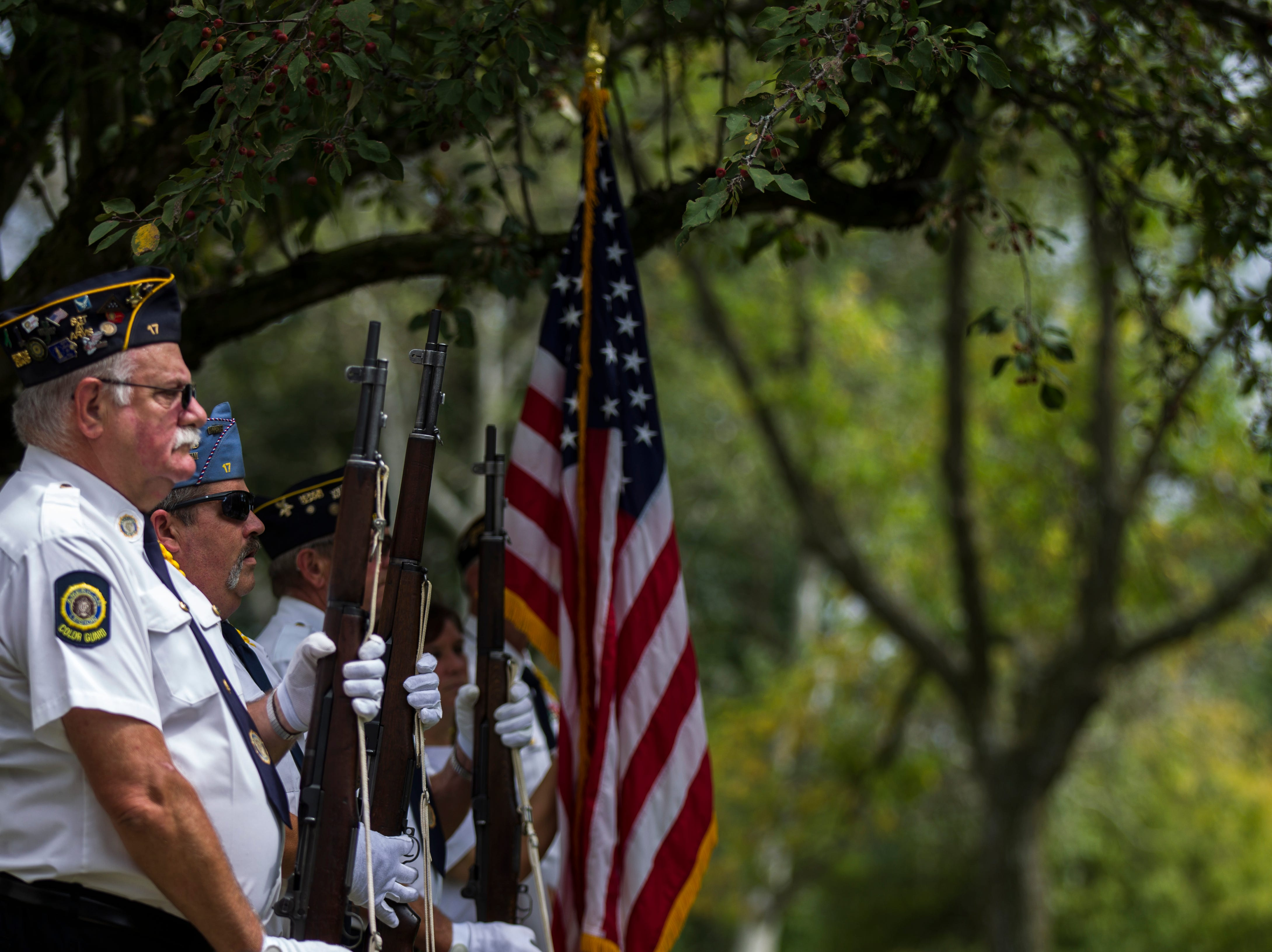 Members of the Iowa City American Legion Post 17 and Coralville Post 721 stand before performing a 21-gun salute during a dedication ceremony on Monday, Sept. 3, 2018, at the Autumn Park Apartments in Iowa City.