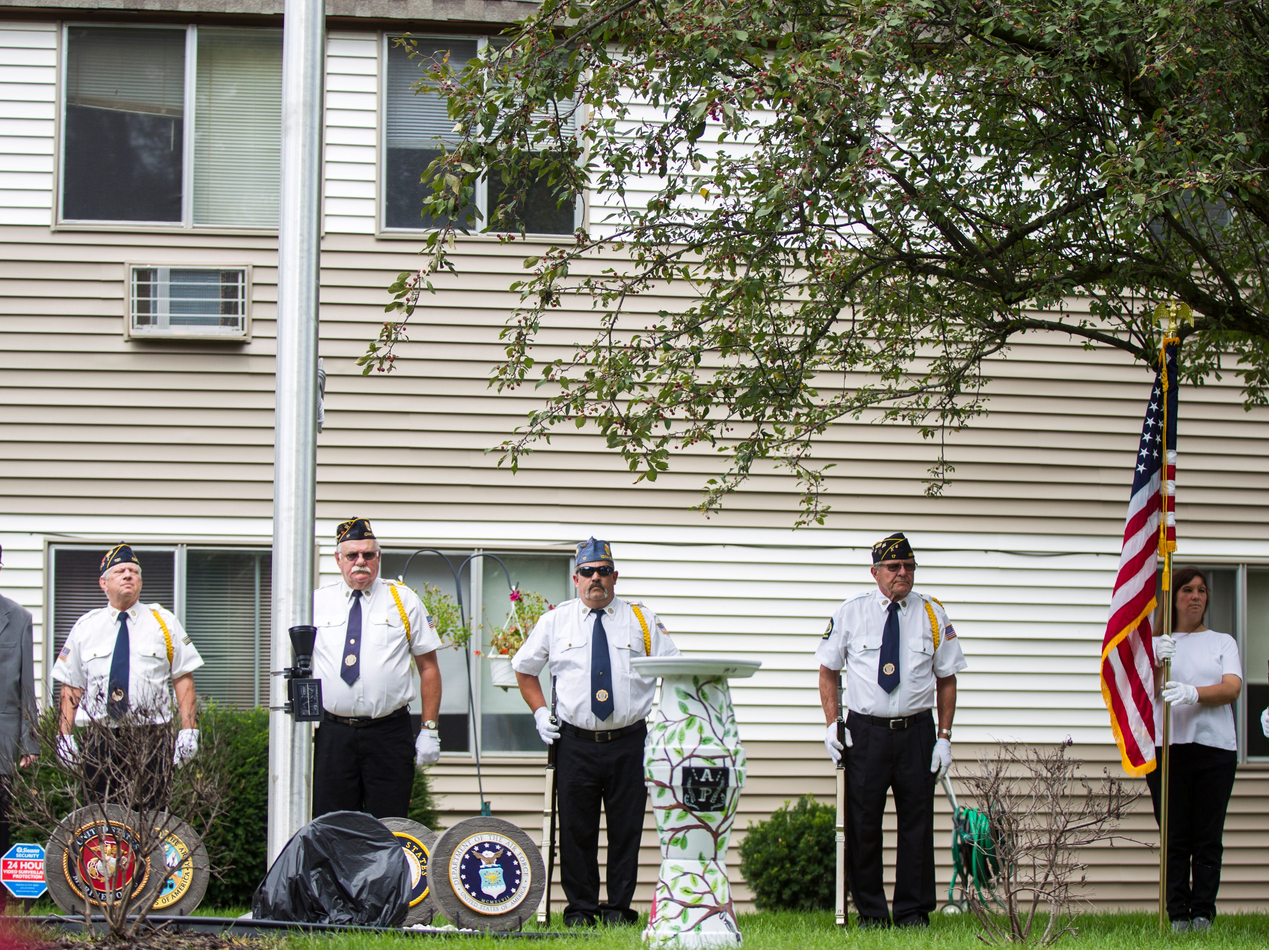 World War II U.S. Navy veteran Russell H. Ware (left) stands with members of the Iowa City American Legion Post 17 and Coralville Post 721 during a dedication ceremony on Monday, Sept. 3, 2018, at the Autumn Park Apartments in Iowa City.
