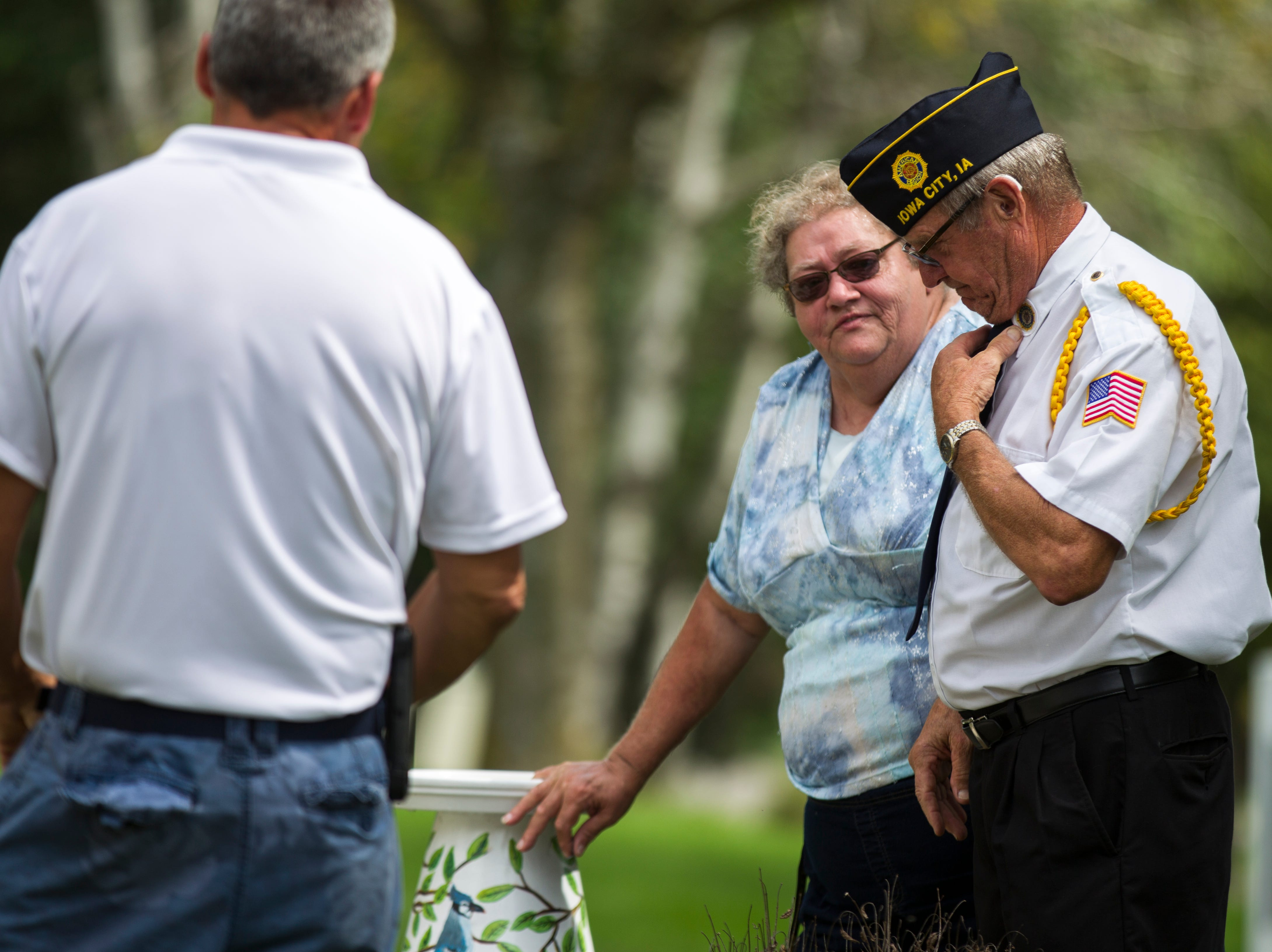 Retired U.S. Navy shipfitter second class Gary Haman (right) speaks with Carol Larson, Autumn Park Apartment resident manager, during a dedication ceremony on Monday, Sept. 3, 2018, at the Autumn Park Apartments in Iowa City. Haman served in the Navy during Vietnam and is a current member of the Iowa City American Legion Post 17.