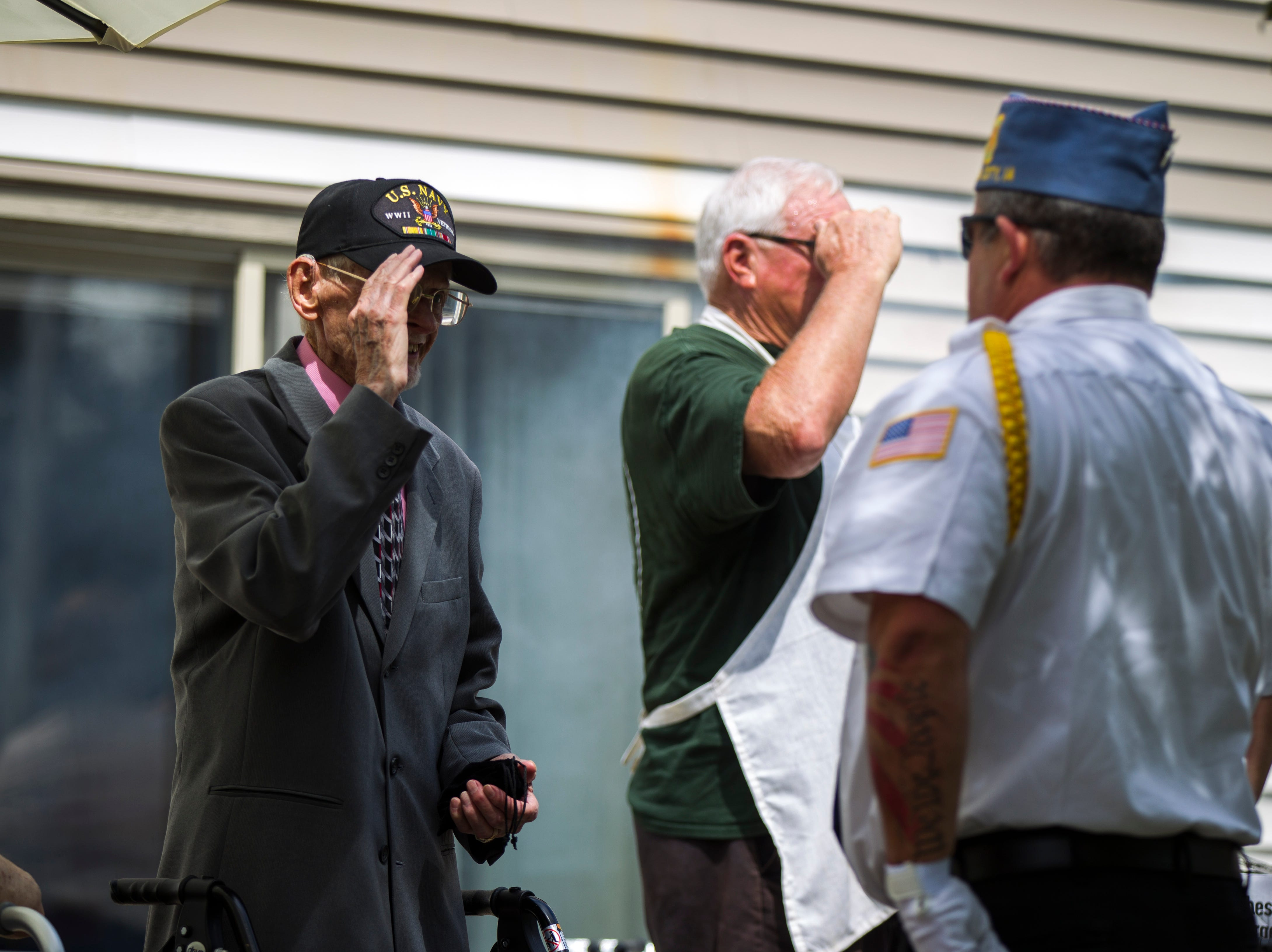World War II U.S. Navy veteran Russell H. Ware (left) is acknowledged during a dedication ceremony on Monday, Sept. 3, 2018, at the Autumn Park Apartments in Iowa City.
