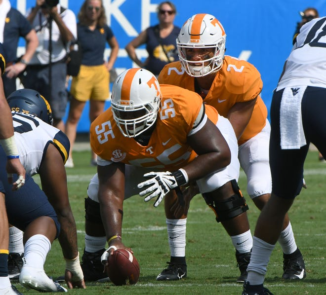 Tennessee center Brandon Kennedy (55) and quarterback Jarrett Guarantano (2) during action against the West Virginia Mountaineers in the Belk College Kickoff game in Charlotte, NC Saturday, September 1, 2018.