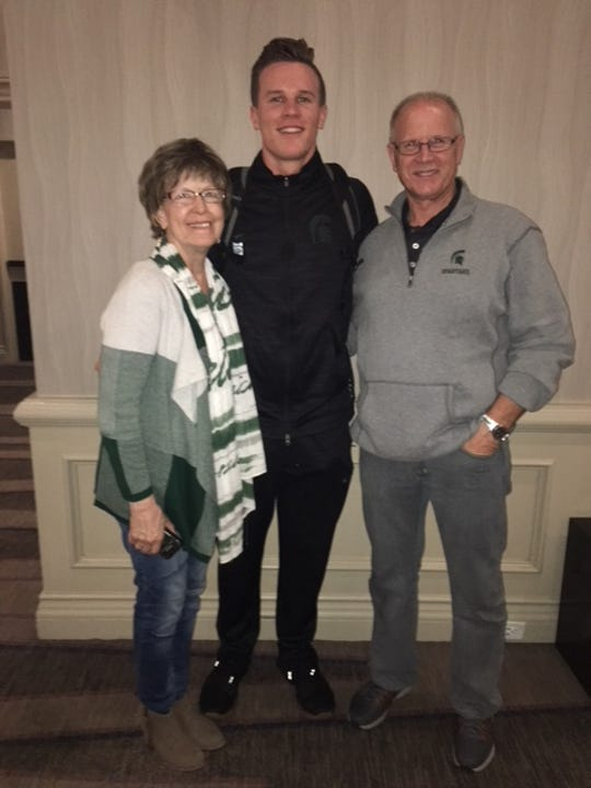 Brian Lewerke poses with his grandfather, Darwin Newton, and his late grandmother, Anne Newton, in San Diego last December around the time of the Holiday Bowl. It was the last game Anne would see. She died on March 11.